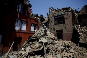 A man collects his belongings from houses damaged by earthquake in Bhaktapur, Nepal, April 27, 2015. (Xinhua/Pratap Thapa)