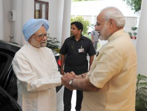 Former India Prime Minister Dr. Manmohan Singh calling on Prime Minister Narendra Modi, in New Delhi on May 27, 2015.