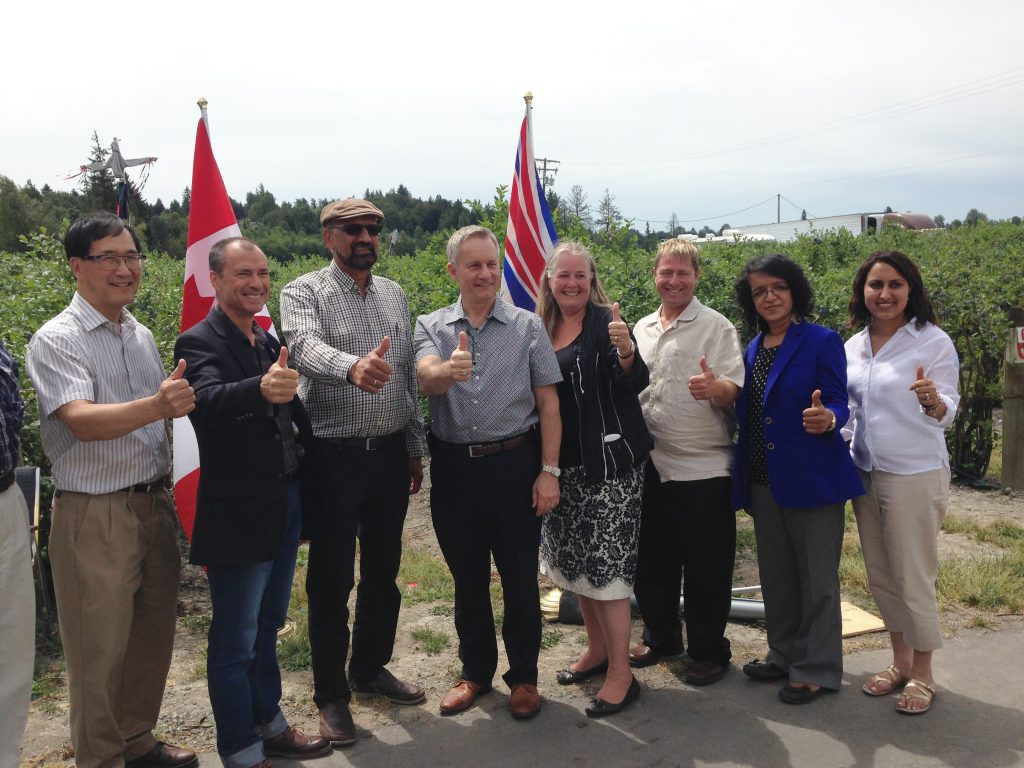 Left to right: Peter Lee MLA, BC Minister Norm Letnik, Parm Bains of West Berry Farms, Int'l Trade Minister Ed Fast, Debbie Etsell, Executive Director BC Blueberry Council, Jason Smith Chair BC Blueberry Council, Simran Bains West Berry Farms, Manlin Lally of Lally Group. Photo: Ray Hudson