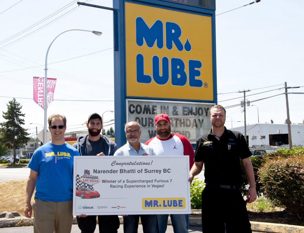 David Waterfall, VP of Marketing for Mr. Lube; Karan Bhatti, Mr. Bhatti's son; Narender Bhatti, the winner; Rohit Bhatti, Mr. Bhatti's son; Mark Wilson, Mr. Lube Store Manager. Photo: Submitted