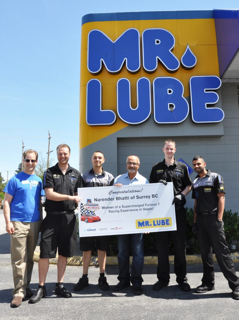 David Waterfall, VP of Marketing for Mr. Lube; Mark Wilson, Mr. Lube Store Manager; Narender Bhatti, the winner pose with location staff.
