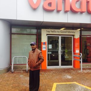"""A photo of Engdasew was taken by Vancity staff outside the Vancity Credit Union's Whalley Branch, where he is now accessing the """"Back to Work"""" Loan."""