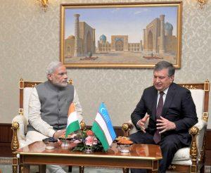 Indian Prime Minister Narendra Modi meeting the Prime Minister of Uzbekistan Shavkat Miromonovich Mirziyoyev at the Meeting Hall of Tashkent Airport, in Tashkent, Uzbekistan on July 06, 2015.