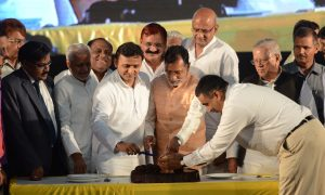 Lucknow: Uttar Pradesh Chief Minister Akhilesh Yadav cuts a cake during a programme organised by his supporters and Samajwadi Party (SP) workers to celebrated his 43rd birthday in Lucknow on July 1, 2015. (Photo: IANS)