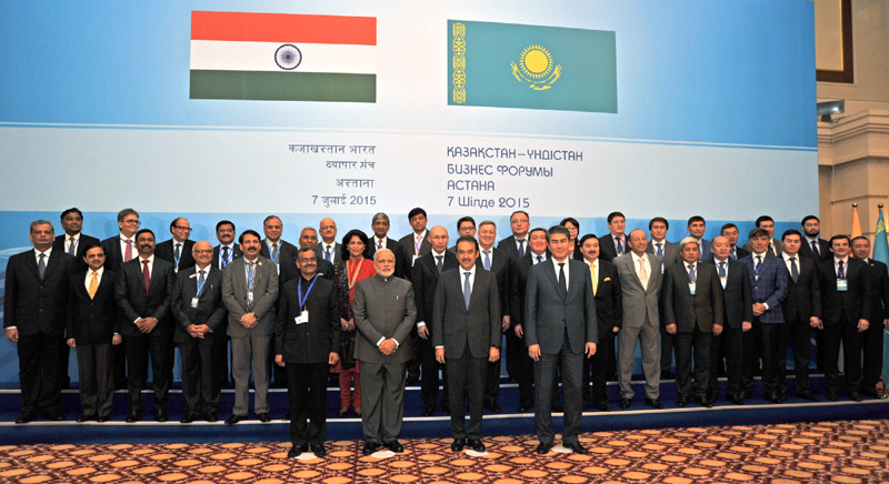 Indian Prime Minister Narendra Modi in a group photograph with the CEOs and business leaders of Kazakhstan and India, in Astana, Kazakhstan on July 07, 2015. The Prime Minister of the Republic of Kazakhstan Karim Massimov is also seen.
