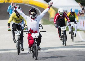 Canadian Tory Nyhaug reacts at the finish line after winning gold in the men's BMX at the Pan American Games in Toronto on Saturday, July 11, 2015. THE CANADIAN PRESS/Nathan Denette
