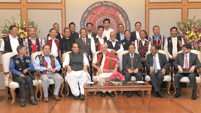 Indian Prime Minister Narendra Modi in a group photo at the signing ceremony of historic peace accord between Government of India & NSCN, in New Delhi on August 03, 2015. Home Minister Rajnath Singh is also seen.