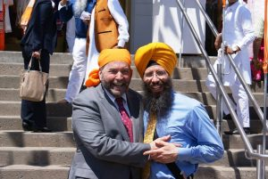 Martin Singh with his party leader Tom Mulcair