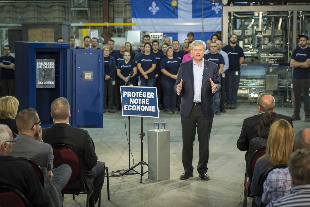 "Prime Minister Stephen Harper announces that a re-elected Conservative government will pass legislation imposing a ""tax-lock"" that prohibits increases to federal income taxes, sales taxes, and new, discretionary payroll taxes, while at Premier Tech in Rivière-du-Loup, September 25, 2015. CPC Photo by Jill Thompson"