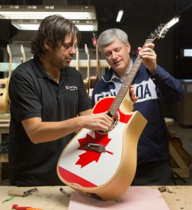 Prime Minister Stephen Harper tours Riversong Guitars in Kamloops, British Columbia, with owner Mike Miltimore, September 14, 2015. CPC Photo by Jason Ransom