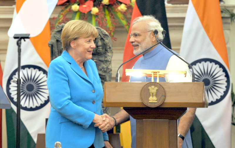 Indian Prime Minister Narendra Modi with the German Chancellor, Dr. Angela Merkel, at the Joint Press Briefing, at Hyderabad House, in New Delhi on October 05, 2015.
