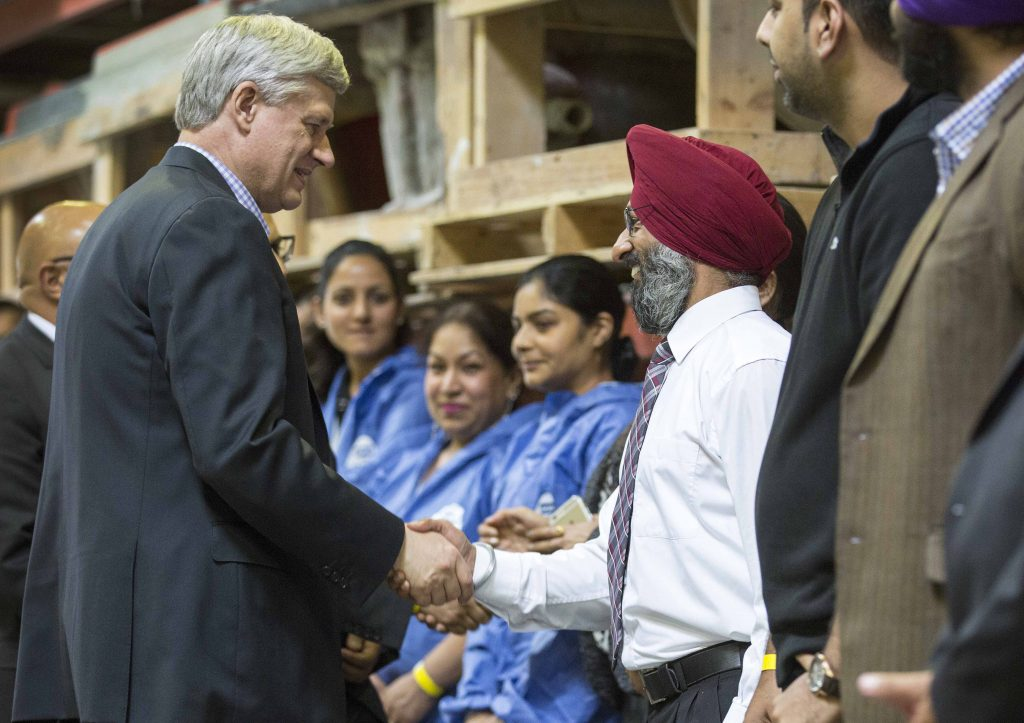 Stephen Harper meets with workers at Fibretech Distributors Inc. in Surrey, October 8, 2015. CPC Photo by Jill Thompson