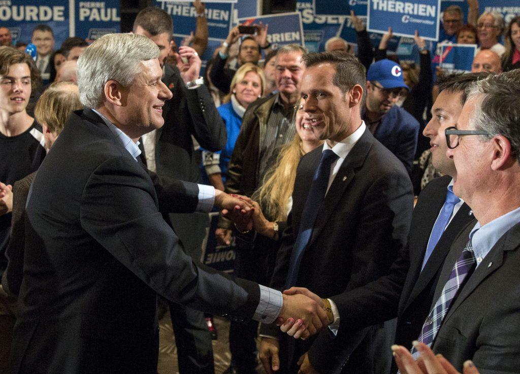 Prime Minister Stephen Harper shakes hands with supporters at a rally in Quebec City, September 30, 2015. CPC Photo by Jill Thompson