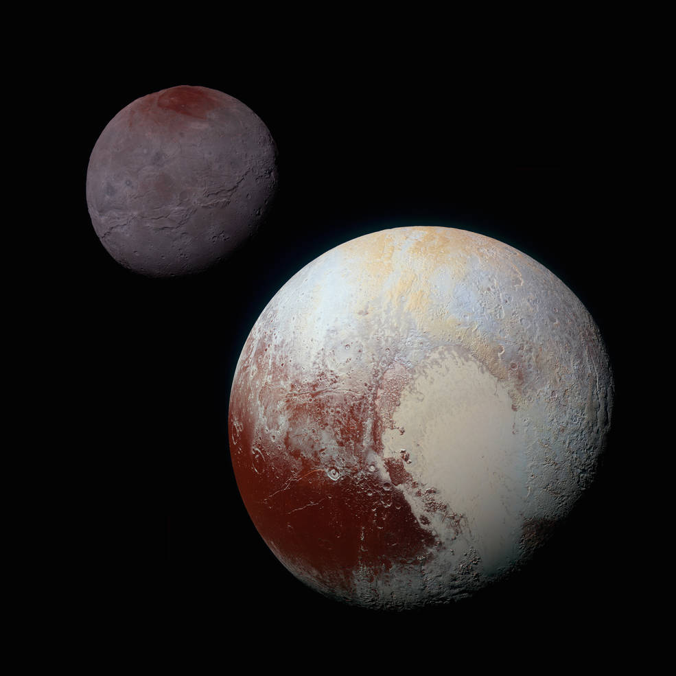 This composite of enhanced colour images of Pluto (lower right) and Charon (upper left) was taken by the New Horizons spacecraft. (Photo: NASA)