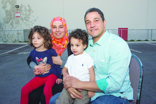 Amen and Ziad Maher with their two children.                   Photo: Ray Hudson
