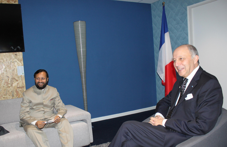 Union Environment Minister Prakash Javadekar French foreign Minister Laurent Fabius at the CoP21 French Presidency office in Paris, France. (Photo: IANS)