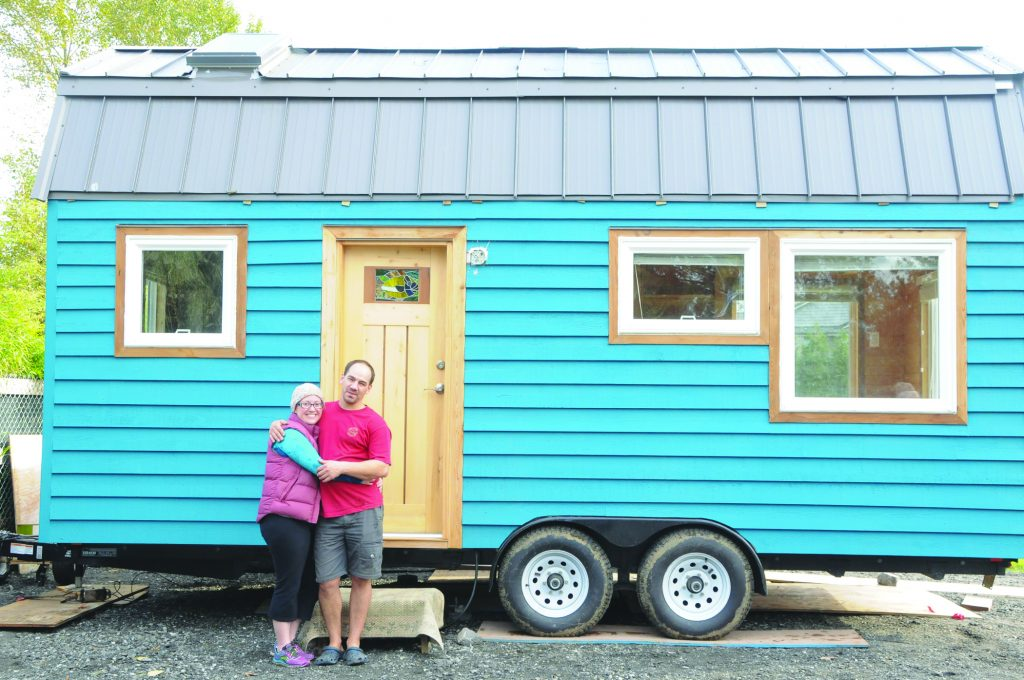 Rory and Laura in front of their newly built tiny home.