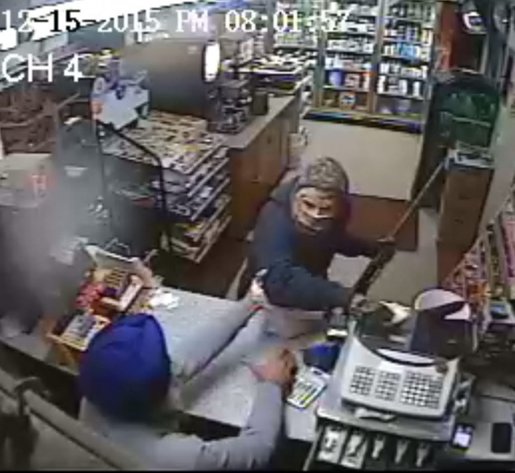 Amrik Singh is seen confronting a masked gunman Tuesday (Dec. 15, 2015) at his petrol station in Staatsburg, about 160 km from New York City, in a still from a surveillance video. Singh threw a slipper at the gunman trying to rob the store ,momentarily distracting him, and charged at him. The gunman fled after firing a shot that missed Singh. (Credit: Courtesy of New York State Police)