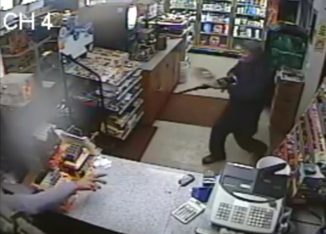 A slipper thrown by Amrik Singh is seen flying towards a masked gunman Tuesday (Dec. 15, 2015) at his petrol station in Staatsburg, about 160 km from New York City, in a still from a surveillance video. When the would-be robber is momentarily distracted when the slipper hit him in the face, Singh charged at him. The gunman fled after firing a shot that missed Singh. (Credit: Courtesy of New York State Police)