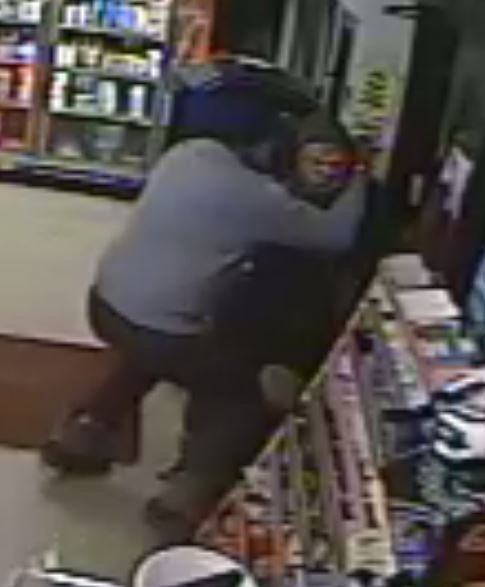 Amrik Singh is seen grappling with a masked gunman Tuesday (Dec. 15, 2015)  at his petrol station in Staatsburg, about 160 km from New York City, in a still from a surveillance video. Singh threw a slipper at the gunman trying to rob the store and charged at him. The gunman fled after firing a shot that missed Singh. (Credit: Courtesy of New York State Police)