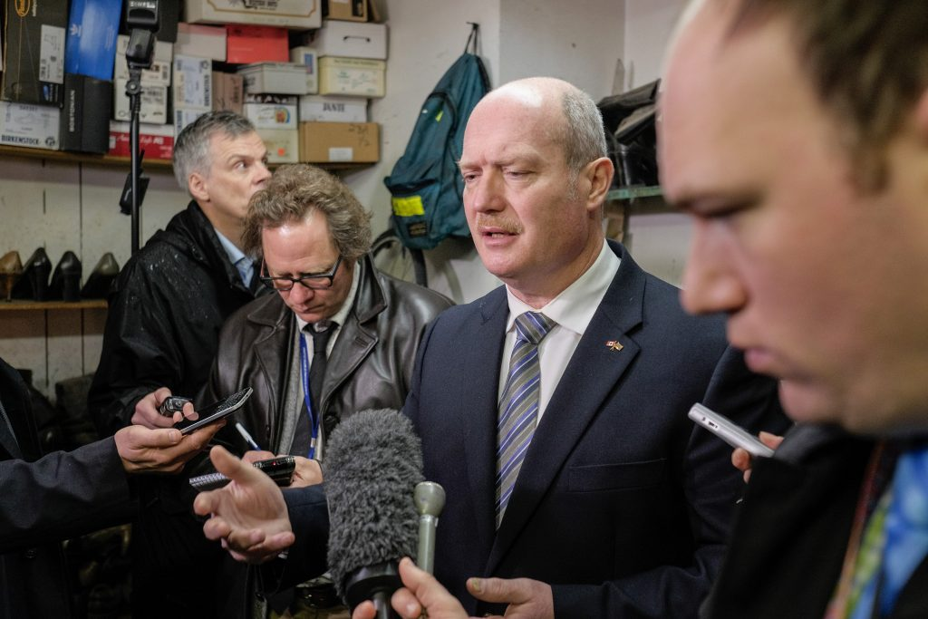 Continuing a BC parliamentary tradition, Finance Minister Mike de Jong picked up his 2016 Budget shoes. The minister has had the same shoes repaired at Olde Towne Shoe Repair for the past four years. Photo: BC Newsroom