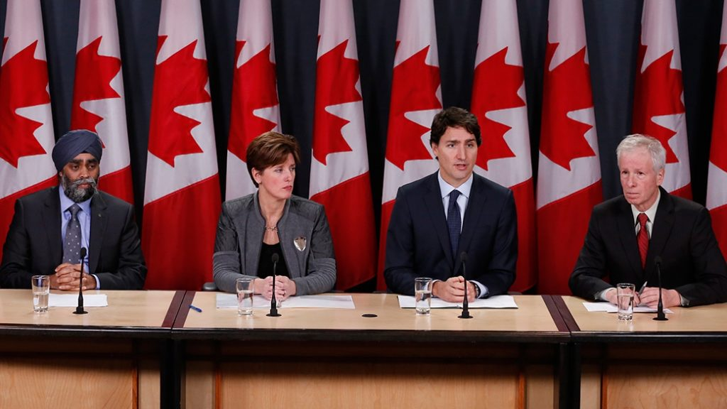 The Prime Minister, Justin Trudeau,  along with the Minister of Foreign Affairs, the Honourable Stéphane Dion (right), the Minister of National Defence, the Honourable Harjit S. Sajjan (furthest left), and the Minister of International Development and La Francophonie, the Honourable Marie-Claude Bibeau (left), make an important announcement in Ottawa.  Photo: PMO