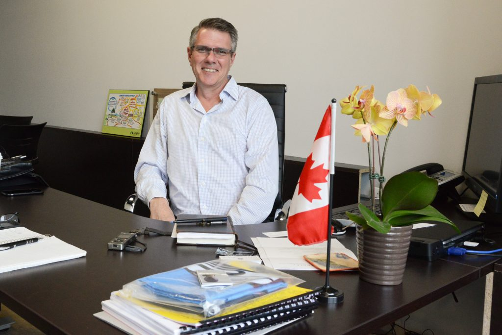 John Aldag in his office on the Fraser Highway on the Surrey Langley border. Photo by Ray Hudson