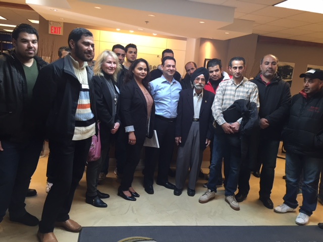Harjinder Bhogal, Paul Bhogal, Sohan Singh Bhogal with Judi Huta (Community & Employer Services Coordinator) and Syrian Refugees