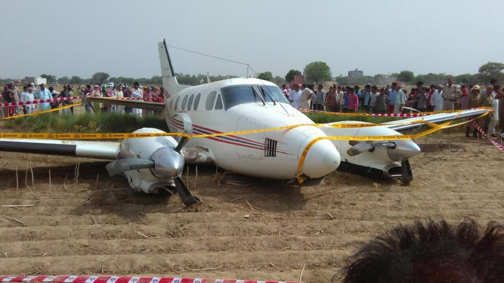 New Delhi: The air ambulance that crash landed in Kair village of Najafgarh in south Delhi on May 24, 2016. Seven people were on board. (Photo: IANS)