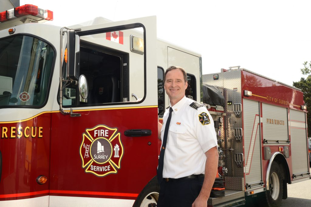 Assistant Chief, Steve Robinson stands by an Engine at Firehall. Photo: Ray Hudson