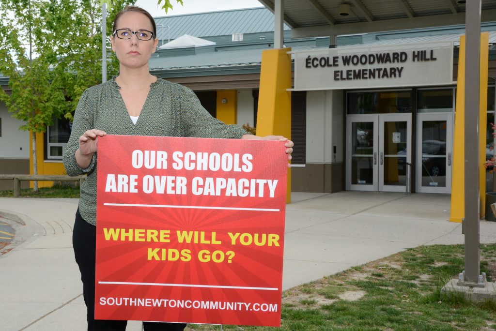 Cindy Dalglish, one of the leaders of the South Newton Community, makes her point in front of her daughter's school where some French Immersion classes may be relocated due to crowding, and before Mayor and Council last Monday evening. Photos: Ray Hudson