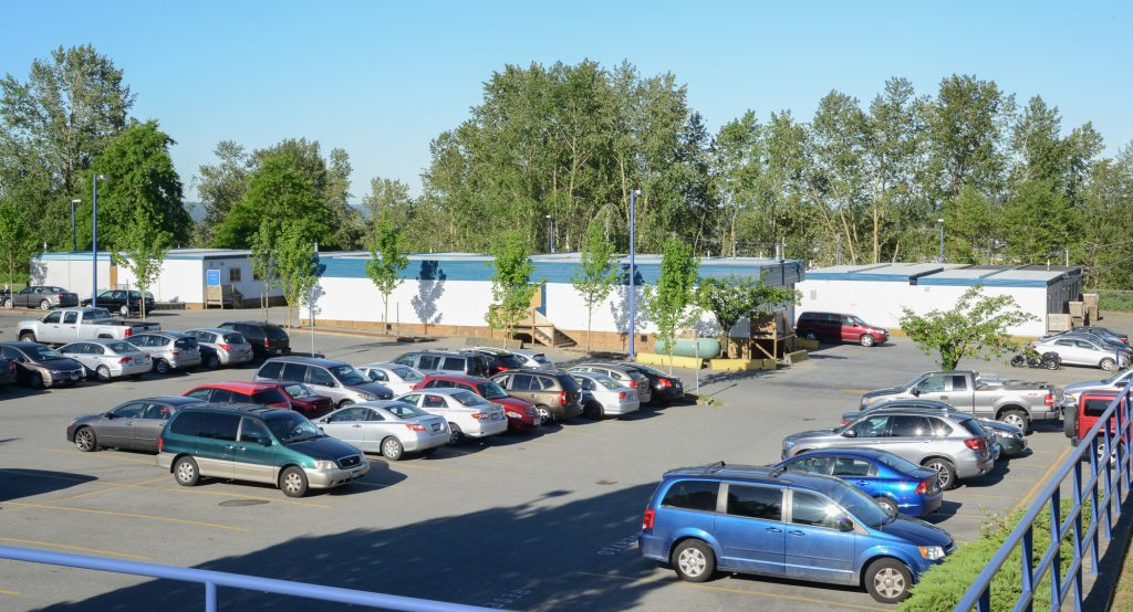 Lord Tweedsmuir Secondary has a parking lot full of portables. Photo: Ray Hudson