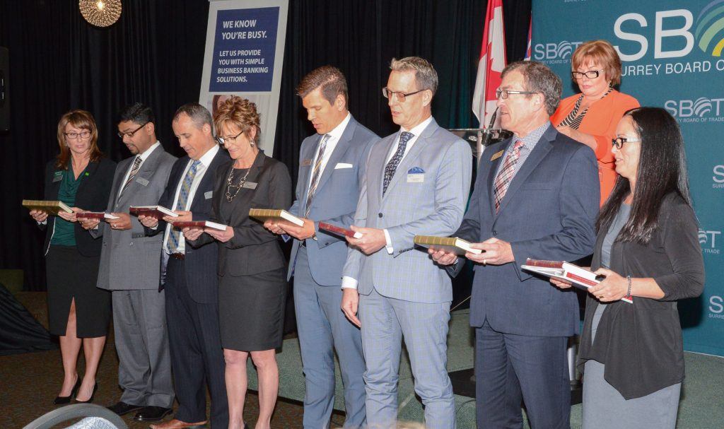 The newly elected and re-elected Directors Surrey Board of Trade for 2016-2017 were sworn in by Mayor Linda Hepner. From left, Tammy Rae TD Bank, Jay Rao WSP Canada Inc, John Folka KPMG, Marlyn Graziano KPU, Chuck Keeling Elements Casino, Dr. Greg Thomas G3 Consulting and New Chair, Richard Dendy A&A Contract Customs Brokers, and Immediate Past Chair Shelley Besse nFirst West Credit Union.