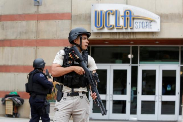 A Los Angeles Metro Police officer stands watch on the University of California, Los Angeles (UCLA) campus after it was placed on lockdown following reports of a shooter in Los Angeles, California June 1, 2016.  REUTERS/Patrick T. Fallon