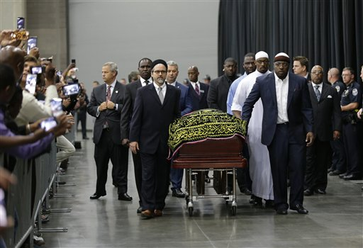 Muhammad Ali's casket arrives at Freedom Hall for his Jenazah, a traditional Islamic Muslim service, Thursday, June 9, 2016, in Louisville, Ky. (AP Photo/David Goldman)