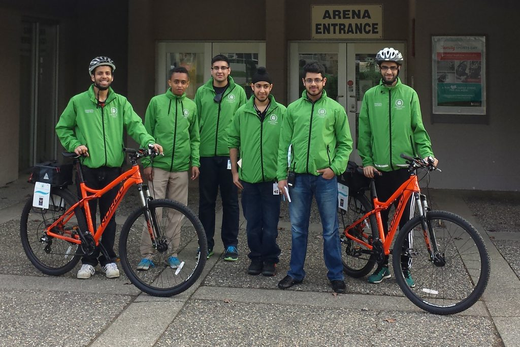 Volunteers pose with their bikes at the Newton Arena.  Photo: Ray Hudson