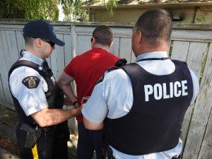 CRU officers making arrest