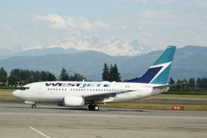 One of seven WestJet daily flights taxis to the terminal with Mount Baker in the background. Photo: Ray Hudson