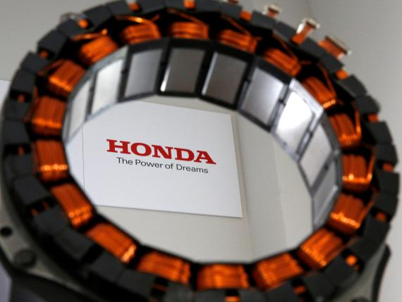 A unit for the i-DCD drive motor, the world's first electric motor for hybrid cars that uses no heavy rare earth metals, jointly developed by Honda Motor Co. and Daido Steel Co., is displayed at an unveiling in Tokyo, Japan July 12, 2016. REUTERS/Issei Kato