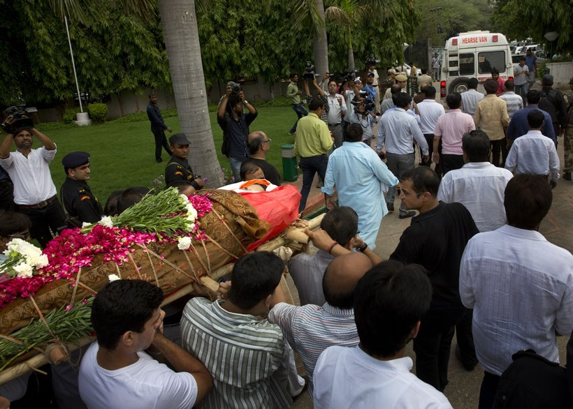 Relatives and friends of Tarishi Jain, a victim of the attack on Dhaka's Holey Artisan Bakery, carry her body for cremation in Gurgaon, in the outskirts of New Delhi, India, Monday, July 4, 2016. The brutality of the attack, the worst convulsion of violence yet in the recent series of deadly attacks to hit Bangladesh, has stunned the traditionally moderate Muslim nation and raised global concerns about whether it can cope with the increasingly strident Islamist militants. (AP Photo/Manish Swarup)