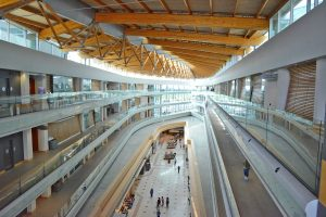 Designed by BC Architect Bing Thom, the campus is integrated with the Central City Mall with the roof designed to resemble an overturned boat.  Many of the classrooms are located in the five floors built above the mall concourse.