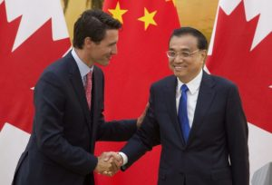 Chinese Premier, Li Keqiang, right, shakes hands with Canadian Prime Minister Justin Trudeau following a joint news conference at the Great Hall of the People in Beijing, China, Wednesday, Aug. 31, 2016.  (Adrian Wyld/The Canadian Press via AP)
