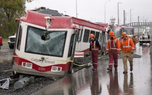 Crews attend the scene of an LRT accident and derailment in northwest Calgary, Alberta on Tuesday, Sept. 20, 2016. The driver of a Calgary Transit train has been seriously injured in a derailment that happened during the morning rush. The C-train derailed at the Tuscany station at about 7 a.m. THE CANADIAN PRESS/Larry MacDougal