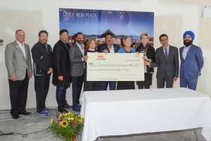 Cheque presentation, from left, Councillors Dave Woods, Mike Starchuk, Tom Gill, Iqbal Grewal, Mayor Linda Hepner, Jay Minhas, Yoland Bauwman, Councillor Mary Martin, Kulwinder Sanghera and Gurdev Sandhu.