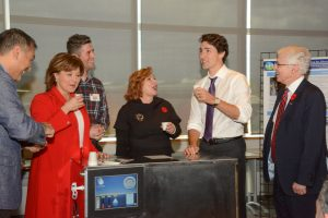 Hybrid Atmospheric Water Generator, which will pull potable water from the atmosphere anywhere there is air. Here, demod Prof. Majid Bahrami, Premier Christy Clark, PhD student Farshid Bagheri co-developer, Mayor Linda Hepner, Prime Minister Justin Trudeau and SFU President Andrew Petter.  Photos: Ray Hudson
