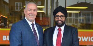 John Horgan with Aman Singh