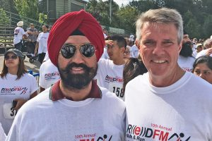 """Satbir Cheema with JohnAldag at the Red FM run."