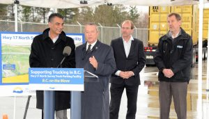 Provincial Ministers and Surrey MLAs Amrik Virk and Peter Fassbender, announce the new truck parking facility with BCTA Vie Chair Ken Johnson and Murray Scadeng of Triton Trucking looking on. Photo: Ray Hudson