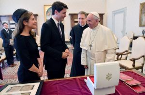 Canadian Prime Minister Justin Trudeau, center, and his wife Sophie Gregoire-Trudeau, left, meet Pope Francis on the occasion of their private audience, at the Vatican, Monday, May 29, 2017. (Ettore Ferrari/Pool Photo via AP)