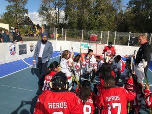 1- Harnarayan Singh Norm Flynn and HEROS kids before game talk
